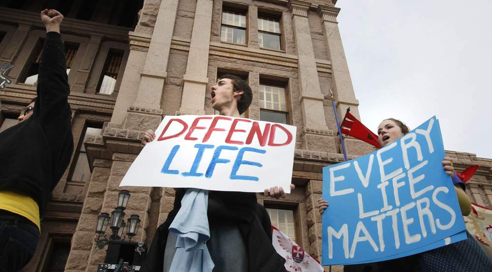 Anti-abortion protesters Roger Garcia, from left, Christian Rodgers and Autumn Clouette attend a rally at the state Capitol in January 2015.Stephen Spillman\/For American-Statesman